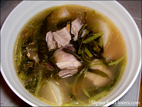 Sinigang na baboy in bowl with sabaw