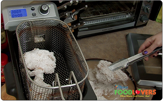 Placing Chicken into Fryer Basket