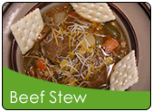 American beef stew in a bowl with saltine crackers